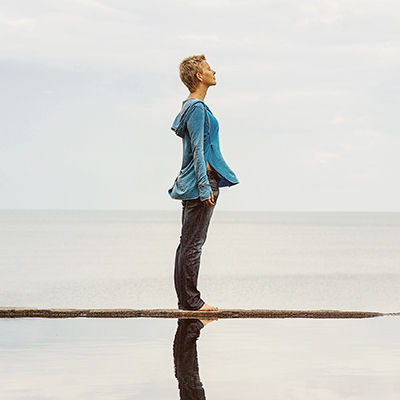 Woman standing peacefully